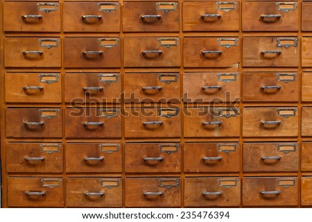 Drawers with blank tags in vintage furniture module