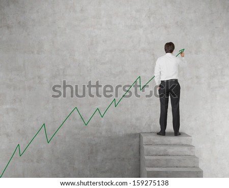 Drawing a growth on a wall - stock photo