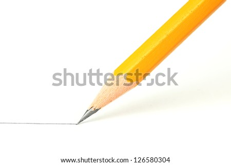 Drawing a line with a pencil - stock photo