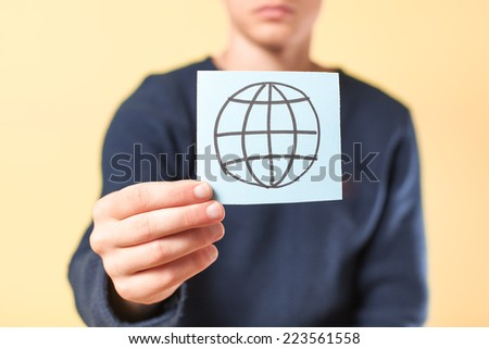 drawing a picture in his hand Internet - stock photo
