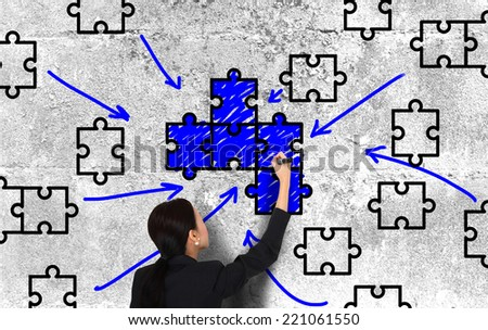 Drawing a piece of puzzle  - stock photo