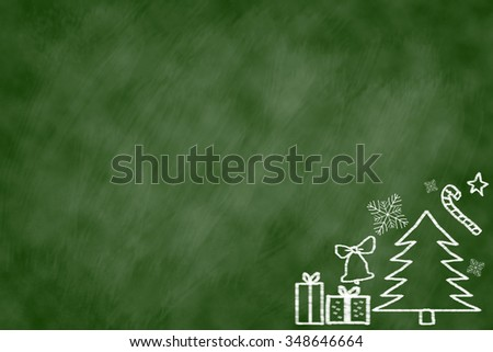 Drawing adorable cute doodle over green chalk board background:Christmas festive display picture concept.xmas decorative wallpaper. - stock photo