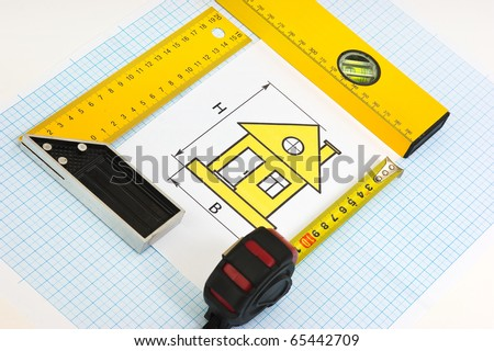 drawing at home with construction tools on a background of graph paper