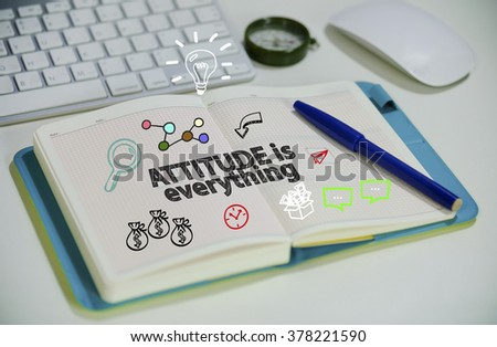 drawing ATTITUDE IS EVERYTHING concept on notebook in the office , business concept , business idea
