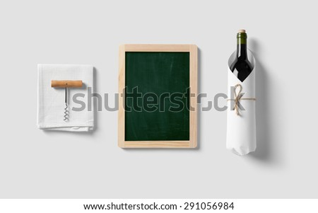 Drawing board and bottle of wine in kitchen