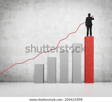 Drawing businessman a line graph and a bar chart. Both symbolize a business growth.  - stock photo
