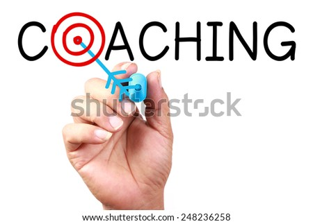 Drawing 'Coaching Target' Concept on transparent white board with blue marker. - stock photo
