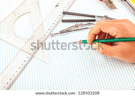 drawing compass in the wooden table - stock photo