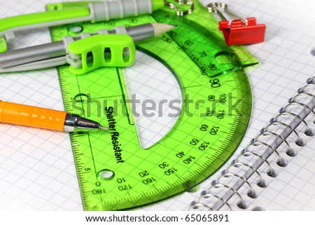 Drawing concept with drawing instruments and note book - stock photo