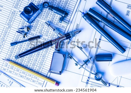 Drawing desk with tools for drawing. In blue tone - stock photo