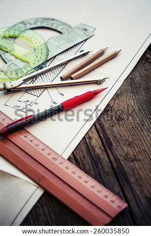 Drawing engine on rustic wooden background. - stock photo