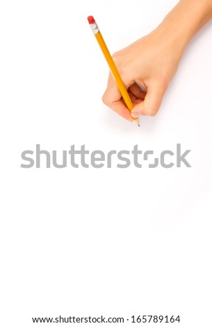 drawing hand with some pencils and a sharpener - stock photo