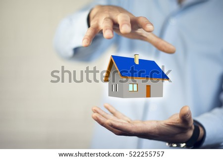 Drawing house in man hands