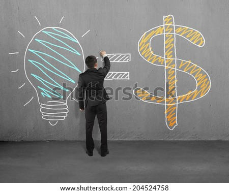 Drawing idea is money concept on wall - stock photo