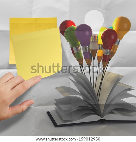 drawing idea pencil and light bulb concept outside the book with splash colors on crumpled paper as creative concept - stock photo