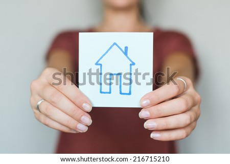 drawing image house in hand - stock photo