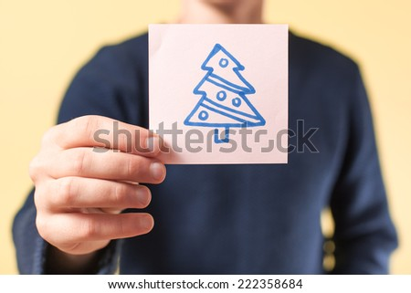 drawing image tree in hand - stock photo