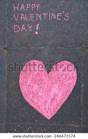 "Drawing in chalk ""Happy Valentine's day"" - stock photo"