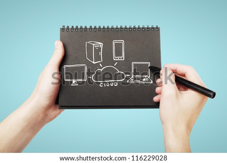 drawing in notebook  cloud computing - stock photo