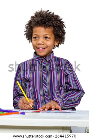 Drawing lesson. Child paints bright pictures. Cheerful boy. - stock photo