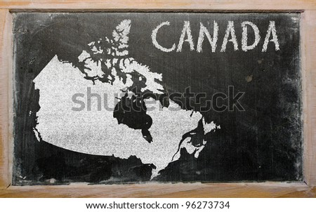 drawing of canada on blackboard, drawn by chalk - stock photo