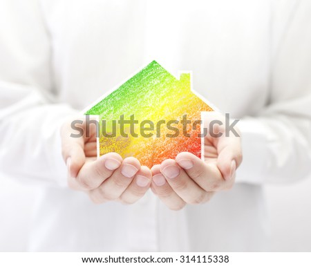 Drawing of colorful house in hands. Energy saving concept. - stock photo