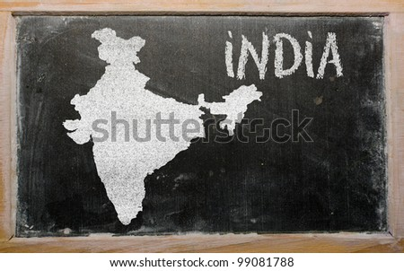 drawing of india on blackboard, drawn by chalk - stock photo