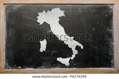 drawing of italy on chalkboard, drawn by chalk - stock photo