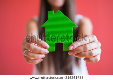 drawing paper house icon in the hand - stock photo