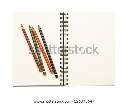 Drawing pencils on a coil bound sketch book