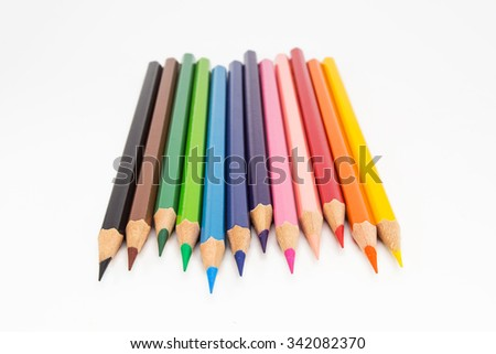 Drawing supplies:  Colorful pencils on colorful pencils, isolated on white background  - stock photo