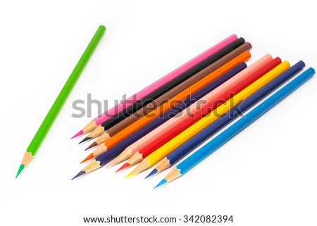 Drawing supplies:  height light green color pencil on colorful pencils, isolated on white background  - stock photo