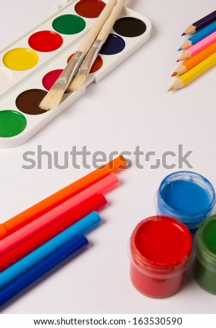Drawing tools on white paper - stock photo