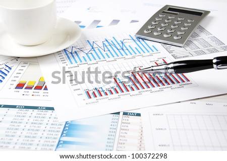 Drawings and charts of successful business, workplace of the businessman