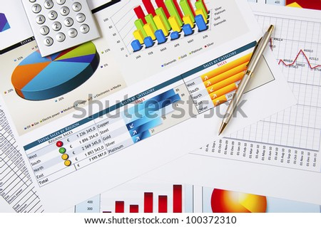 Drawings and charts of successful business, workplace of the businessman - stock photo