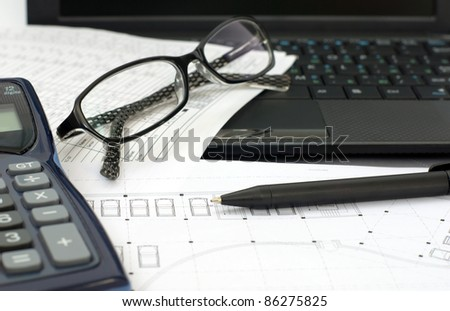 Drawings, pen, keyboard and glasses