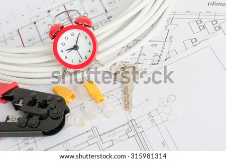Drawings with alarm clock, key and colorful computer wires