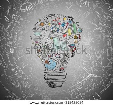 Drawn light bulb with many business symbols - stock photo
