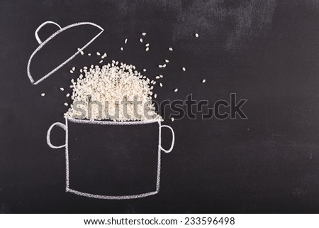 Drawn pot and real rice on the chalkboard with copy-space