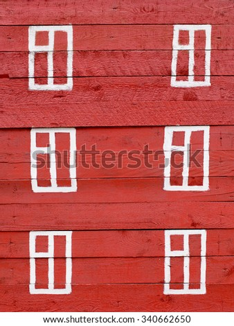 drawn window on wooden wall. three-storey red painted house with white windows on a wooden wall, closeup - stock photo