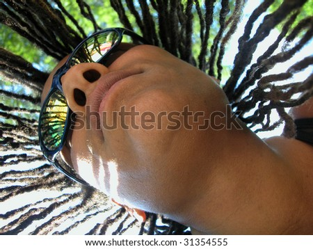 Dread locked woman in swim goggles with reflections. - stock photo
