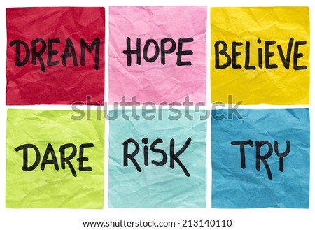 dream, hope, believe, dare, risk, try - motivational concept - a set of isolated crumpled sticky notes with handwritten advice and reminders - stock photo
