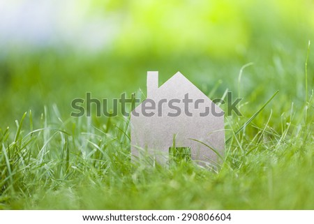 dream house, real estate concept on grass background - stock photo
