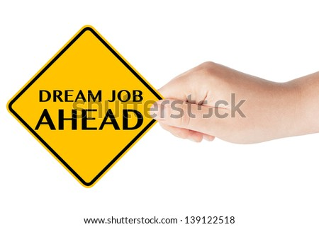 Dream Job Ahead traffic sign in woman's hand on a white background - stock photo