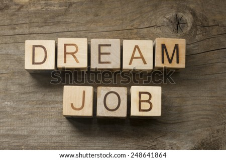 Dream Job text on a wooden background - stock photo