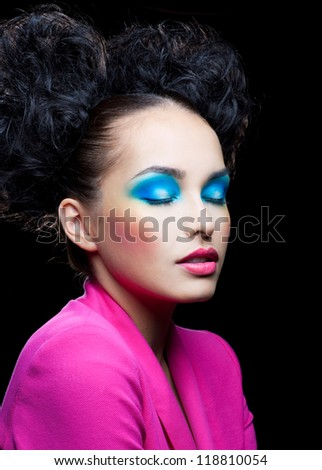 Dream of girl with bright makeup - stock photo