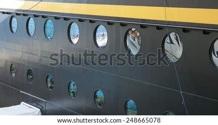 Dream vacation: reflections in cruise ship windows - stock photo
