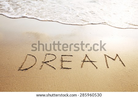 dream - word written on the beach  - stock photo