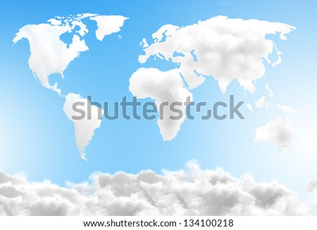 Dream world map made out of clouds over a blue sky - stock photo