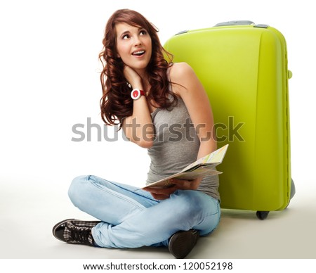 Dreaming about going on vacation - woman witting with big green bag, isolated on white - stock photo